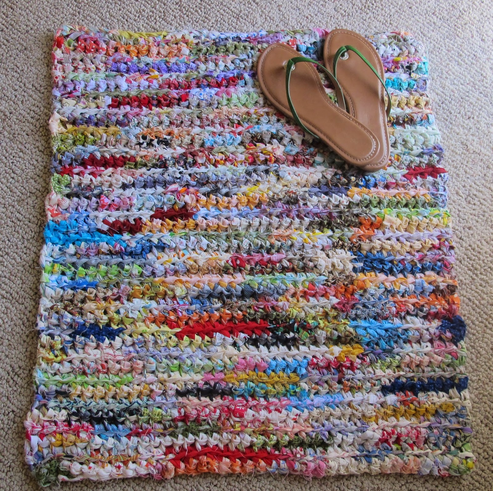 rag crochet rug by pieceful